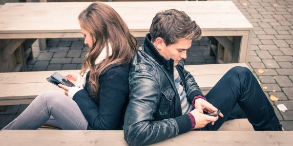 couple back to back on mobile phones
