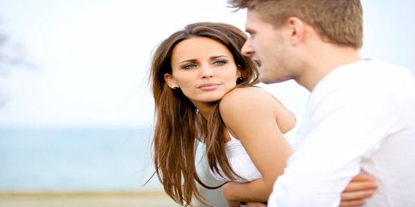 girl suspiciously looking at her boyfriend