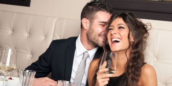 couple dinning together and smiling
