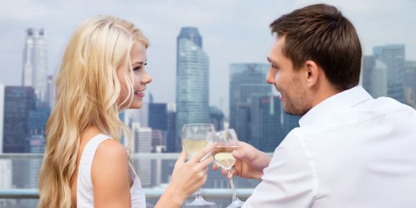 A couple toasting in a balcony